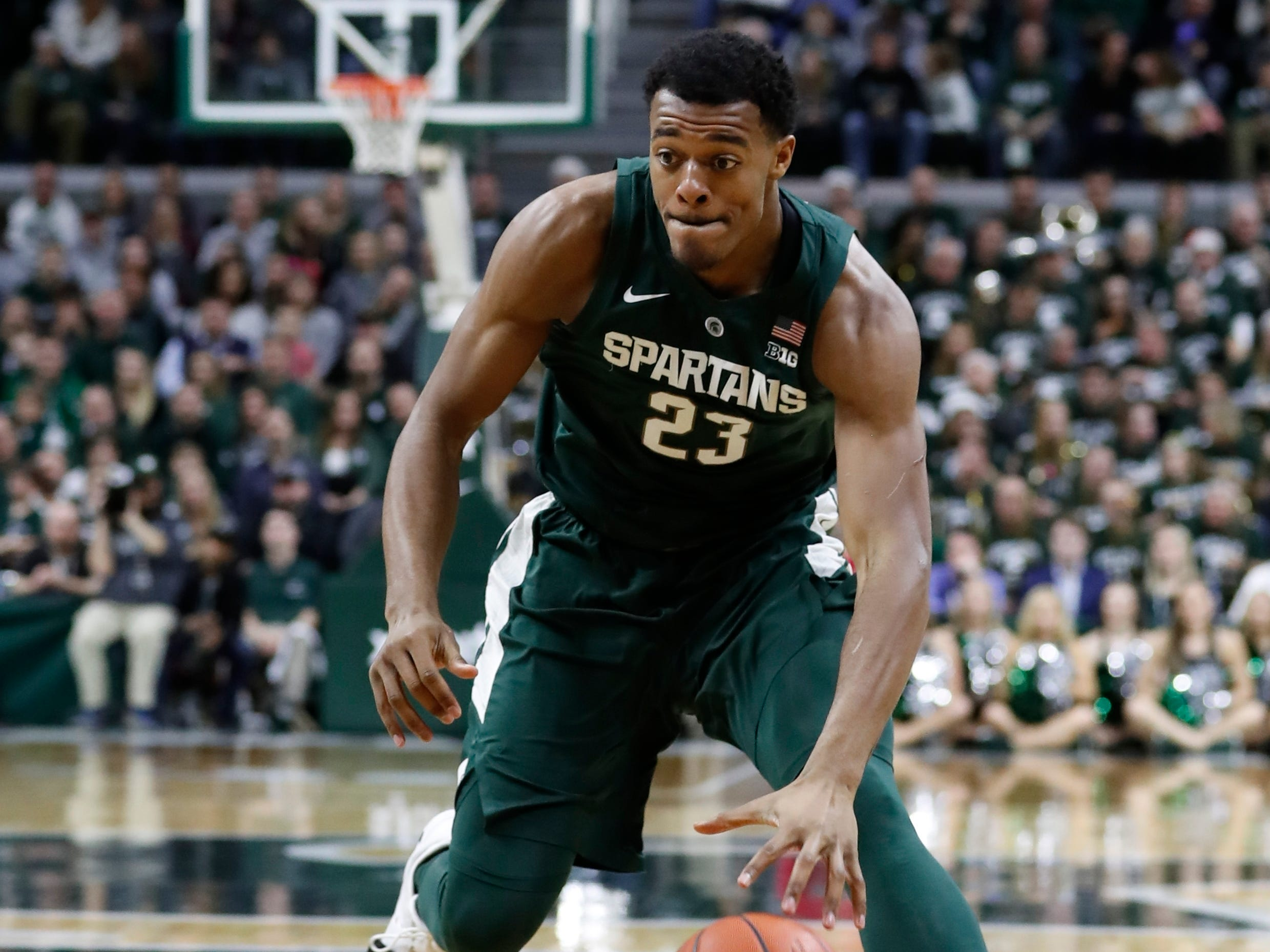 Michigan State forward Xavier Tillman brings the ball up court during the second half of an NCAA college basketball game against Oakland , Friday, Dec. 21, 2018, in East Lansing, Mich.