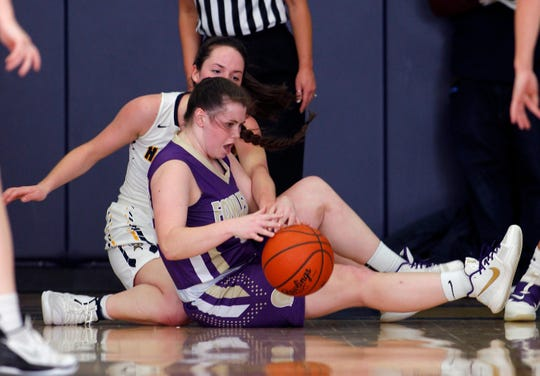 Fowlerville's Jackie Jarvis, front, and Haslett's Ella McKinney fight for the ball, Friday, Dec. 21, 2018, in Haslett, Mich.
