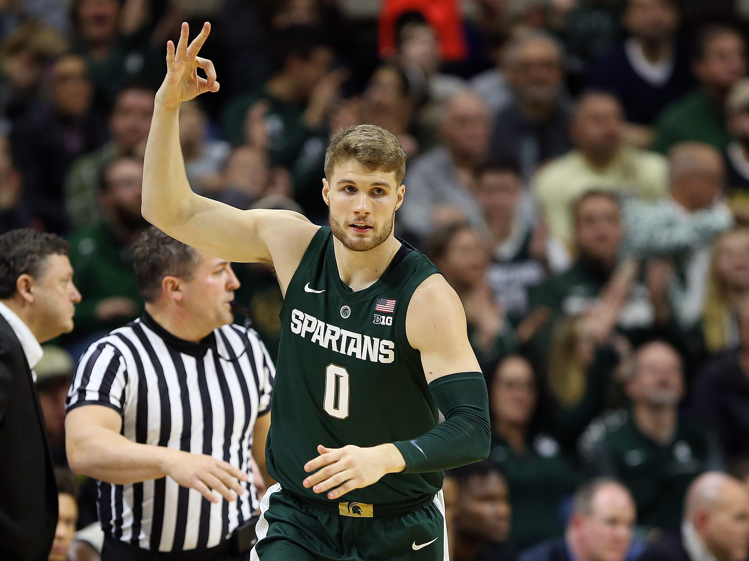 Michigan State Spartans forward Kyle Ahrens (0) reacts during the first half of a game against the Oakland Golden Grizzlies at the Breslin Center.