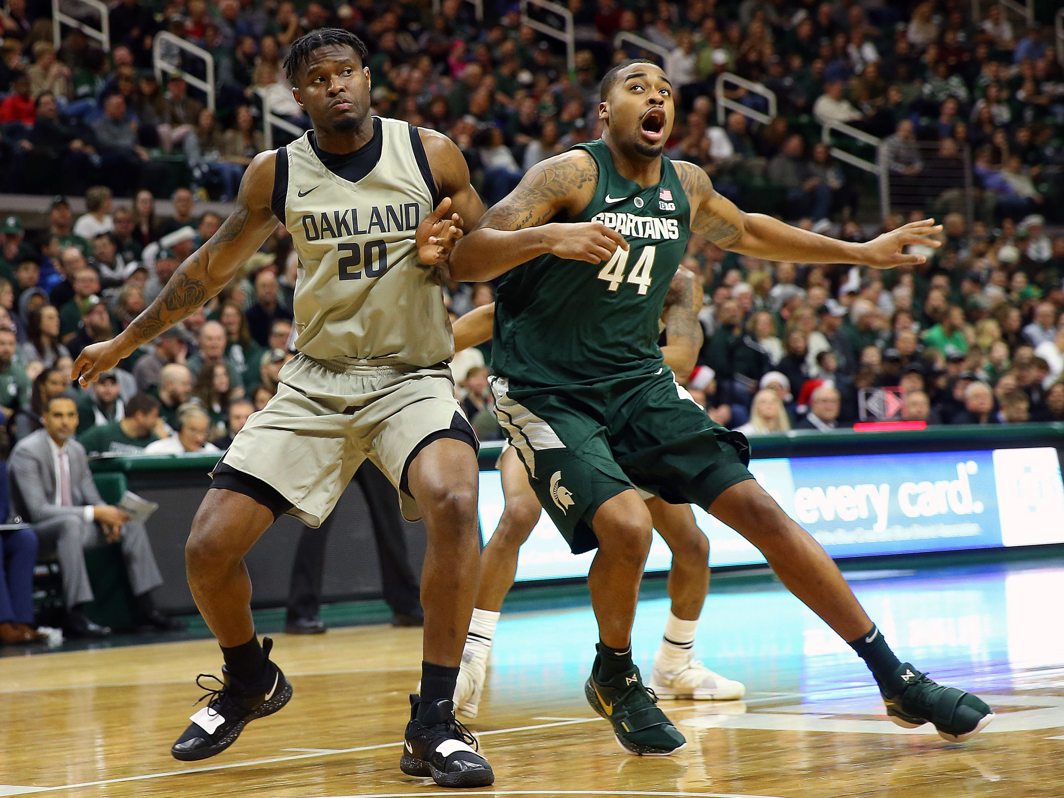 Michigan State Spartans forward Nick Ward (44) and Oakland Golden Grizzlies center Babatunde Sowunmi (20) fight for position during the second half of a game at the Breslin Center.