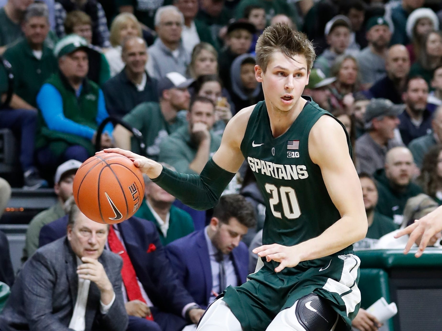 Michigan State guard Matt McQuaid brings the ball up court during the second half of an NCAA college basketball game against Oakland , Friday, Dec. 21, 2018, in East Lansing, Mich.