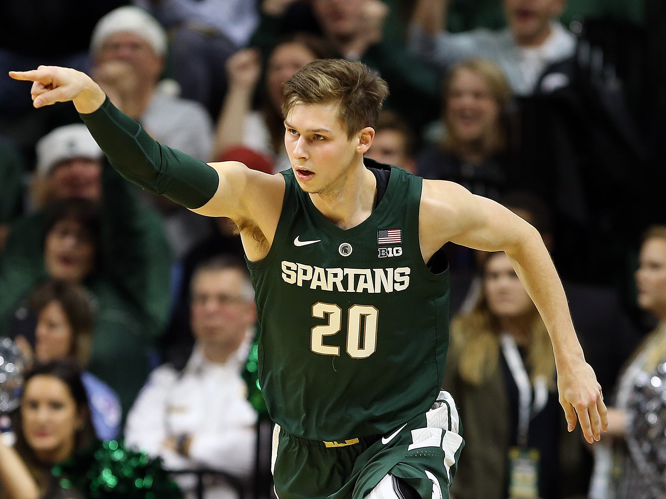 Michigan State Spartans guard Matt McQuaid (20) reacts during the first half of a game against the Oakland Golden Grizzlies at the Breslin Center.
