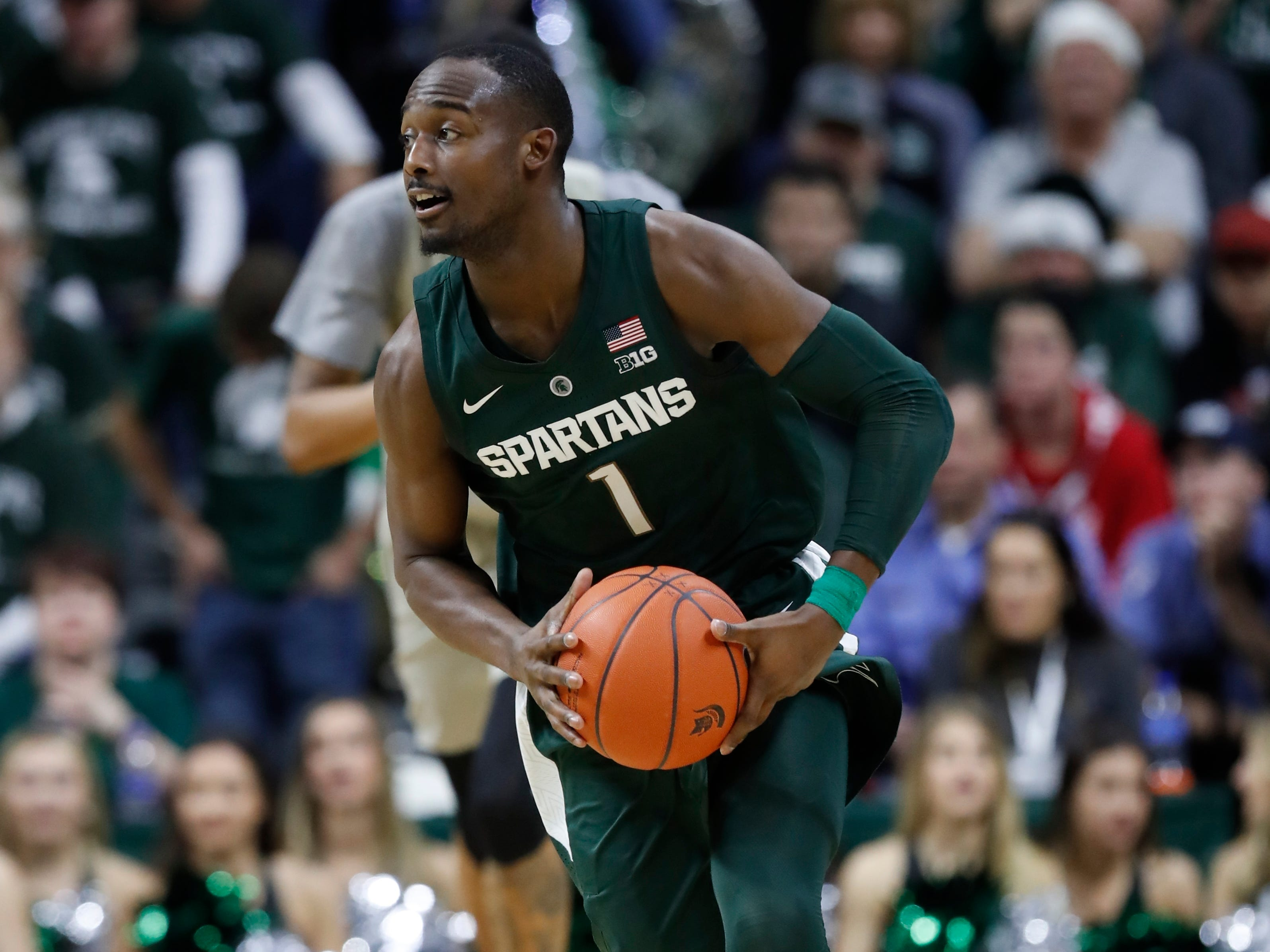 Michigan State guard Joshua Langford brings the ball up court during the second half of an NCAA college basketball game against Oakland, Friday, Dec. 21, 2018, in East Lansing, Mich.
