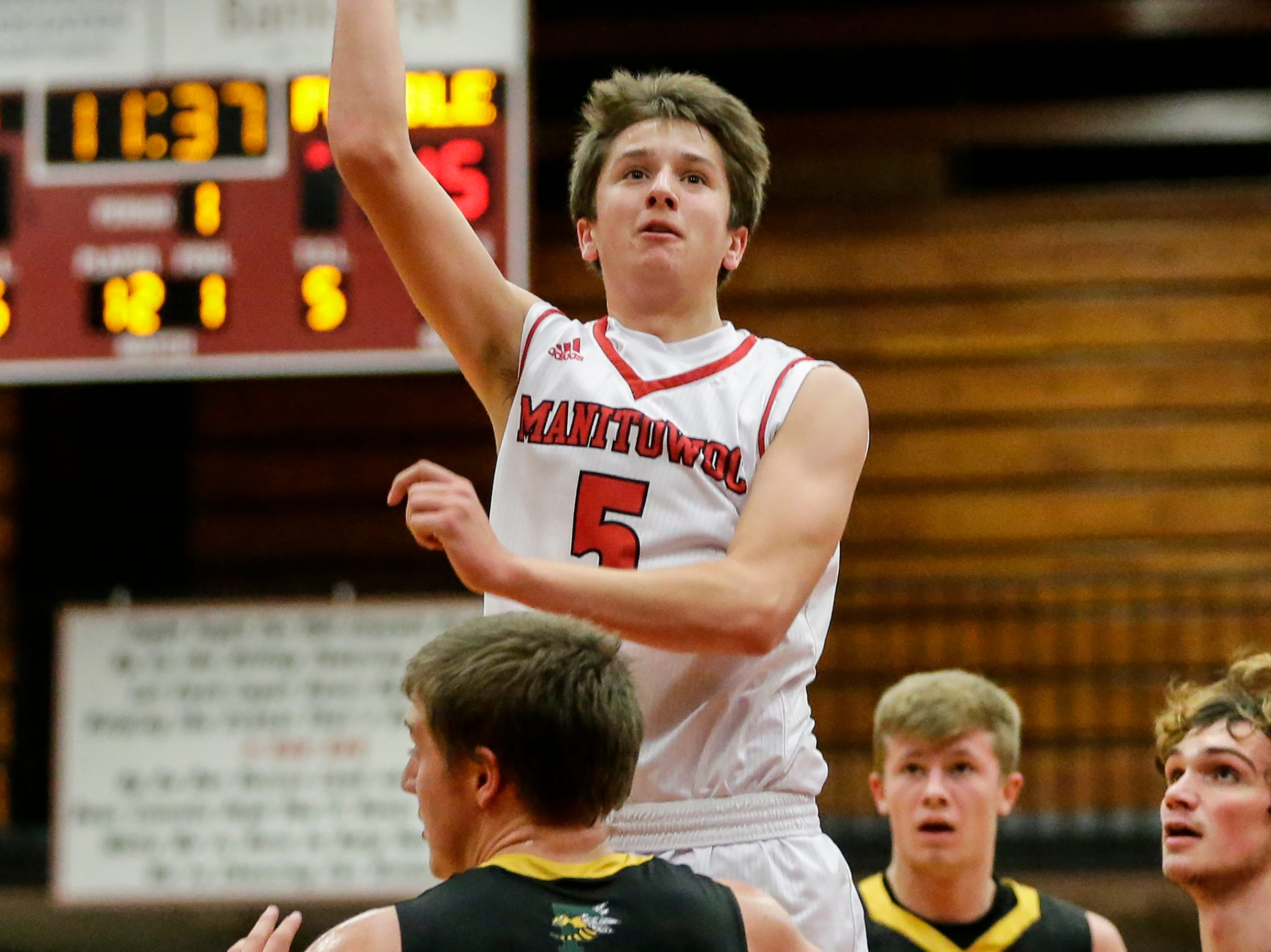 Manitowoc Lincoln's Josh Hoffman puts up a jump shot against Green Bay Preble during boys FRCC basketball at Manitowoc Lincoln High School Friday, December 21, 2018, in Manitowoc, Wis. Joshua Clark/USA TODAY NETWORK-Wisconsin