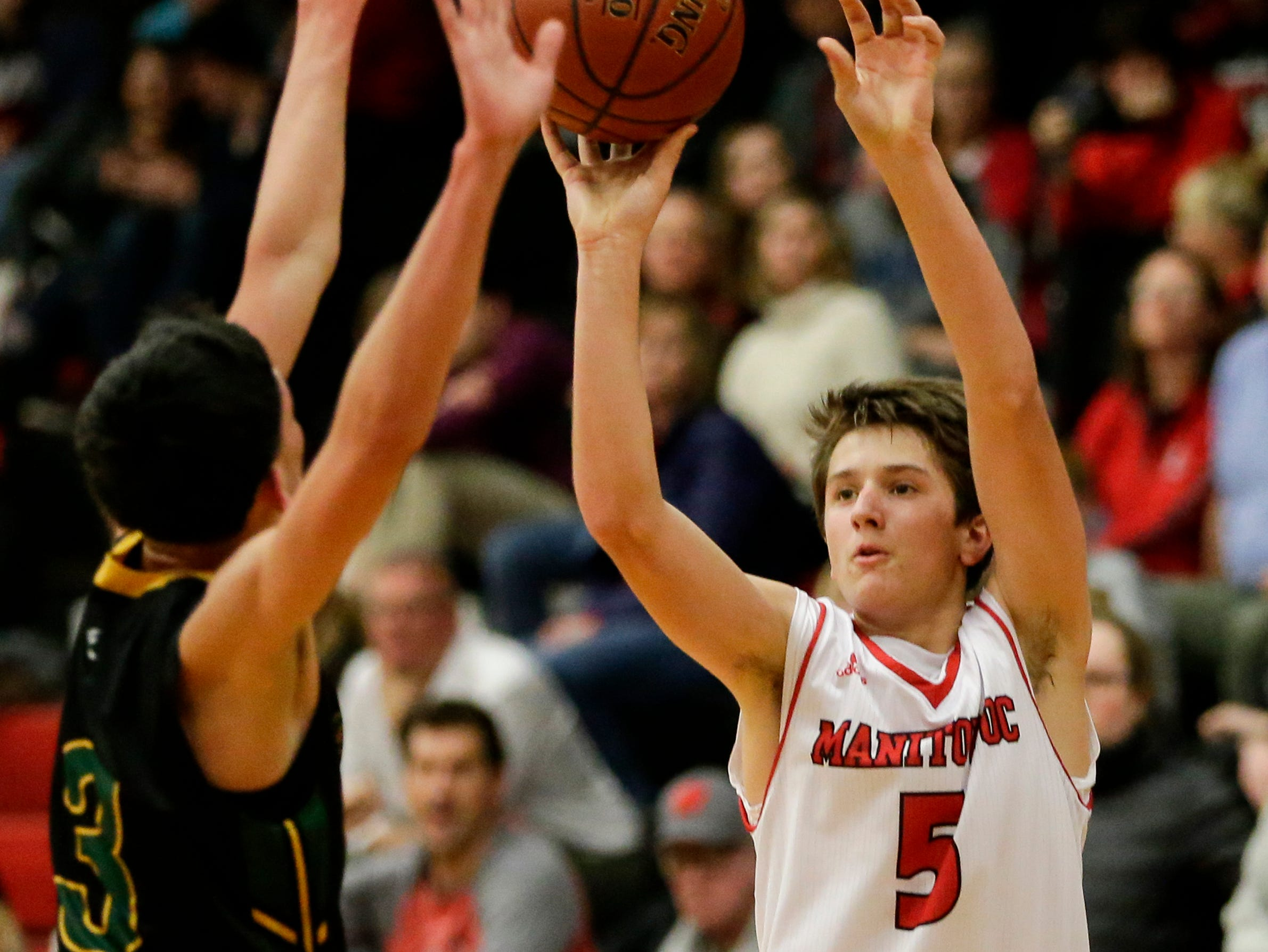 Manitowoc Lincoln's Josh Hoffman puts up a three against Green Bay Preble during boys FRCC basketball at Manitowoc Lincoln High School Friday, December 21, 2018, in Manitowoc, Wis. Joshua Clark/USA TODAY NETWORK-Wisconsin