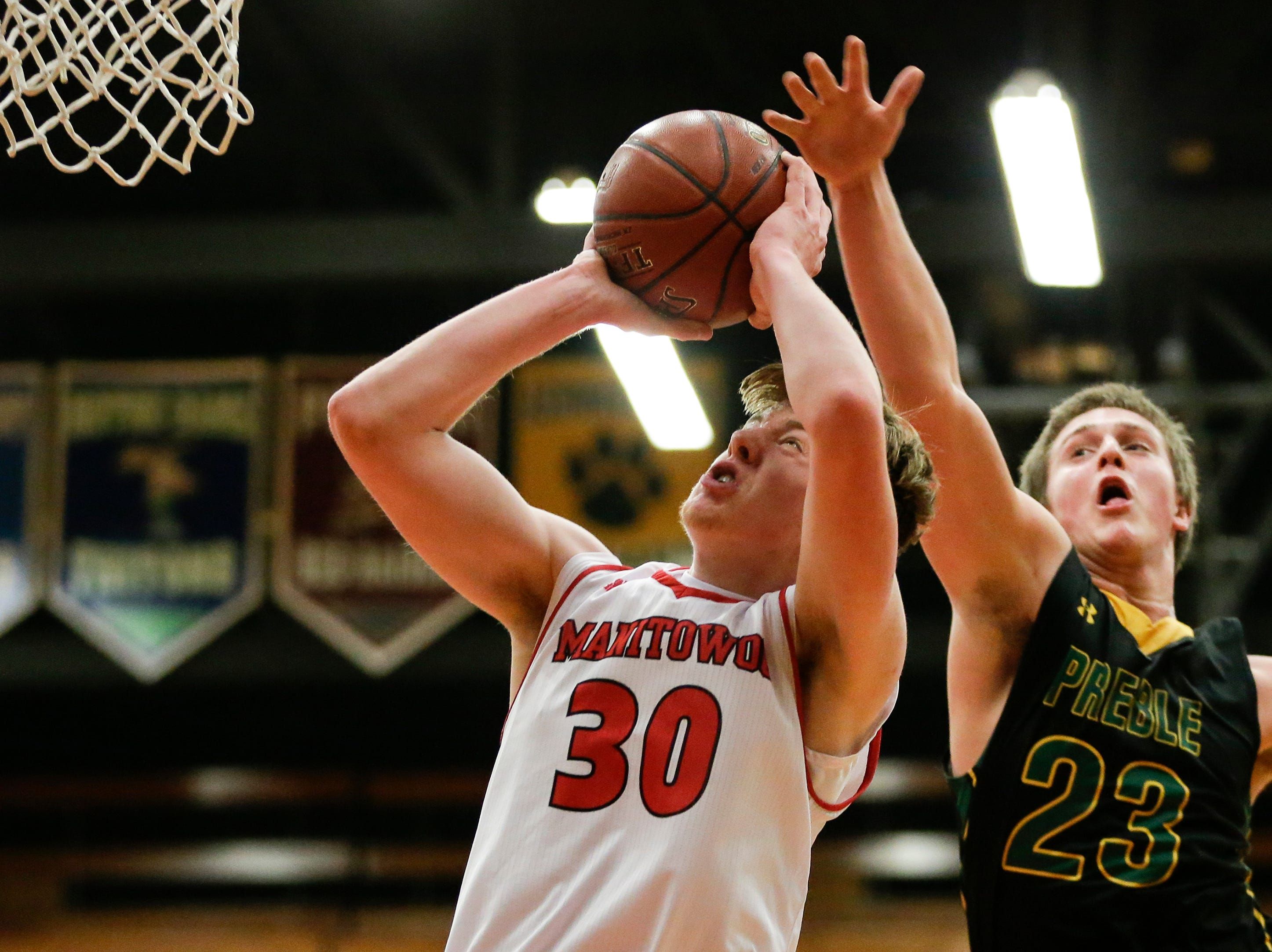 Manitowoc Lincoln's Alec Messman shoots against Green Bay Preble during boys FRCC basketball at Manitowoc Lincoln High School Friday, December 21, 2018, in Manitowoc, Wis. Joshua Clark/USA TODAY NETWORK-Wisconsin