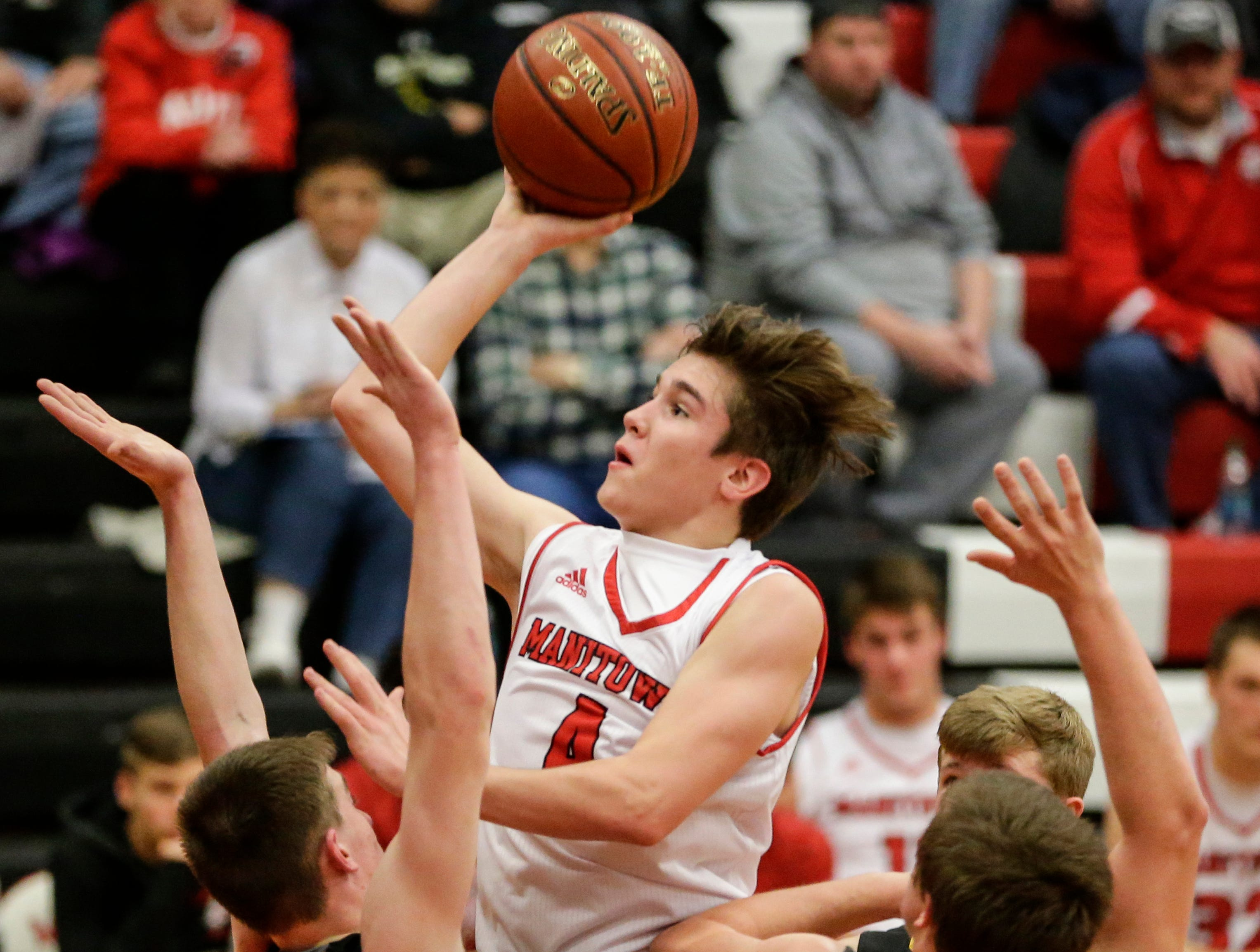 Manitowoc Lincoln's Mason Dopirak drives down the lane for two against Green Bay Preble during boys FRCC basketball at Manitowoc Lincoln High School Friday, December 21, 2018, in Manitowoc, Wis. Joshua Clark/USA TODAY NETWORK-Wisconsin