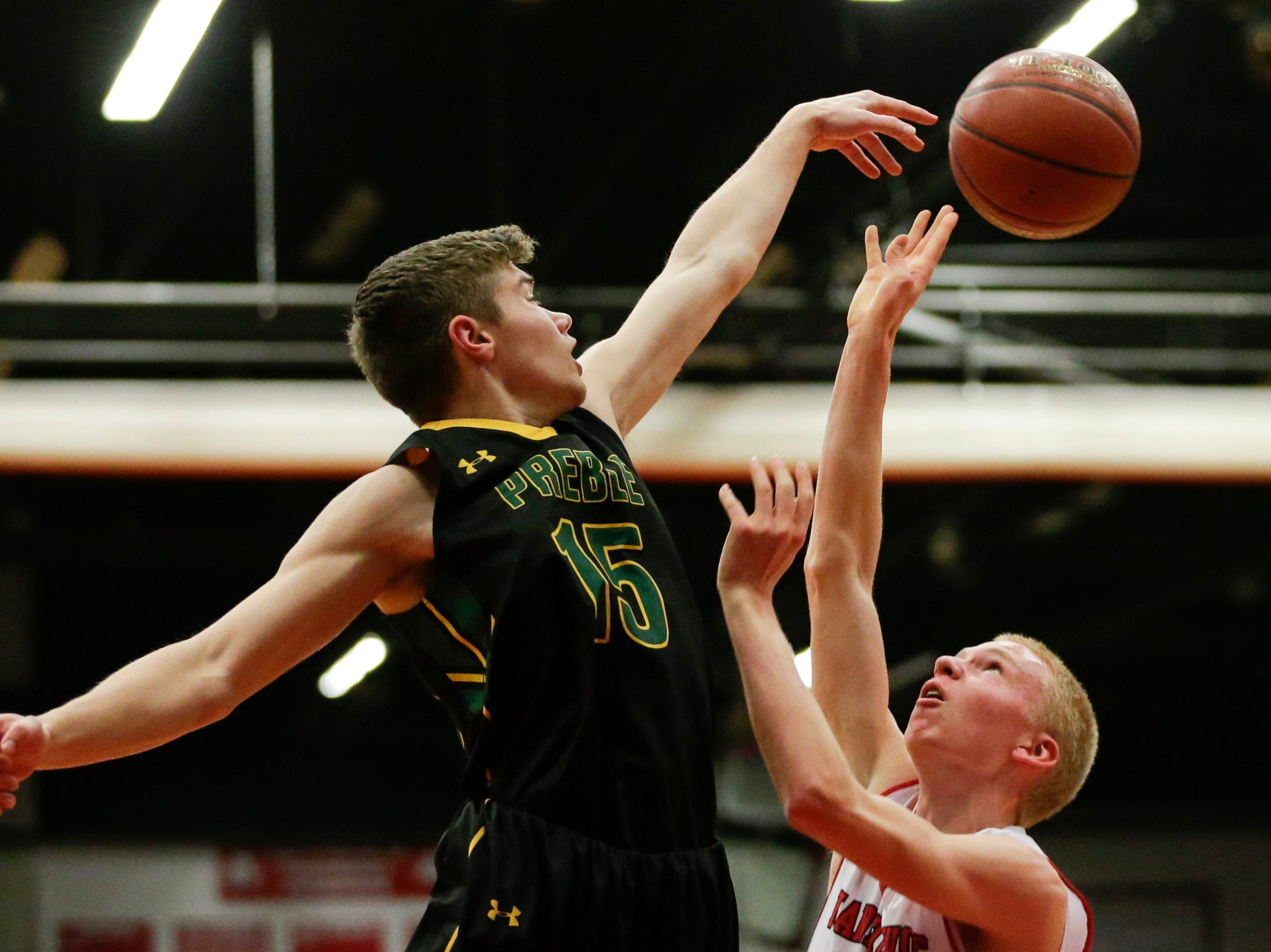 Green Bay Preble's Dominic Mariucci (15) blocks a shot from Manitowoc Lincoln's Sam Jacobson (13) during boys FRCC basketball at Manitowoc Lincoln High School Friday, December 21, 2018, in Manitowoc, Wis. Joshua Clark/USA TODAY NETWORK-Wisconsin