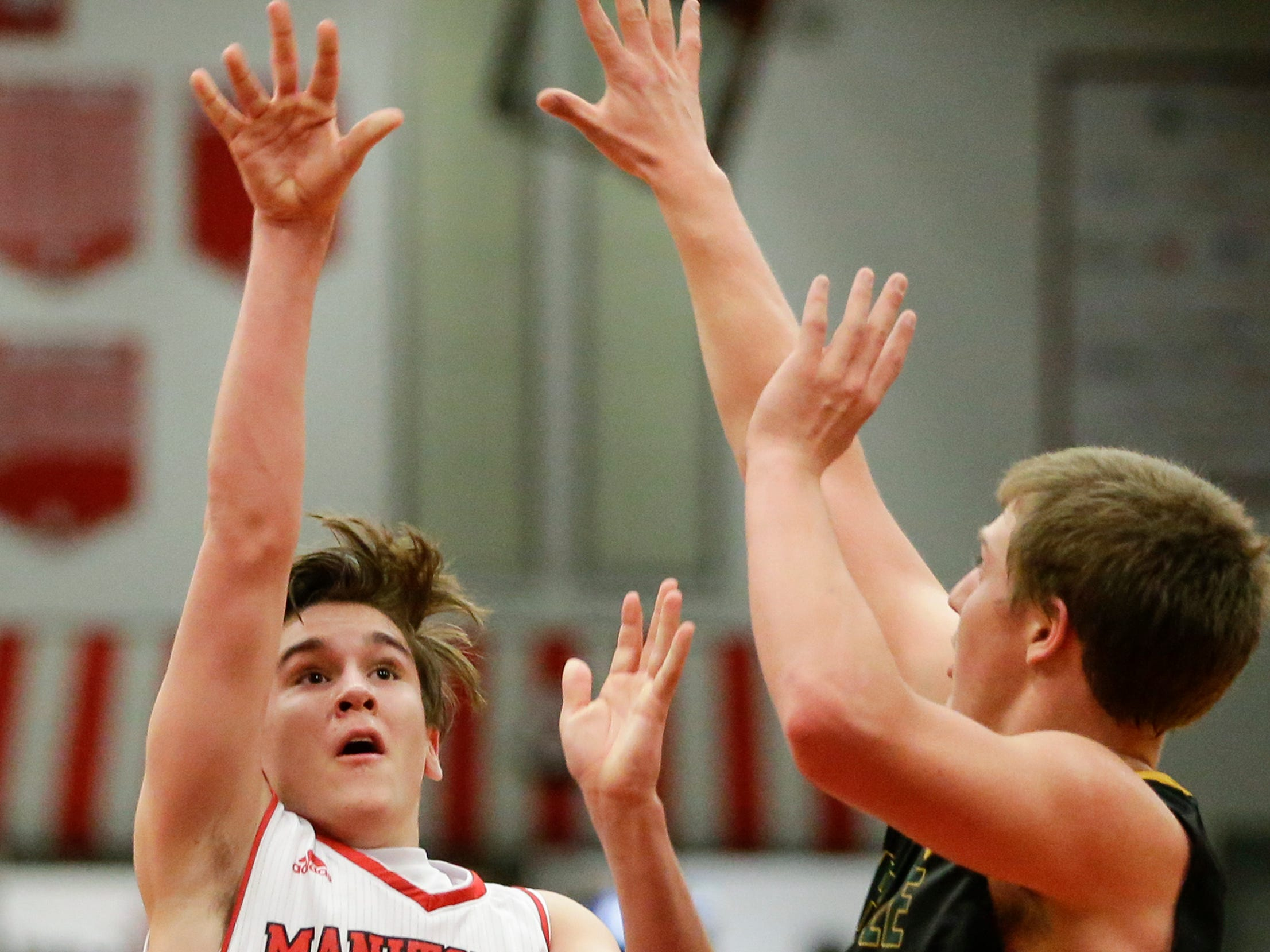 Manitowoc Lincoln's Mason Dopirak shoots against Green Bay Preble during boys FRCC basketball at Manitowoc Lincoln High School Friday, December 21, 2018, in Manitowoc, Wis. Joshua Clark/USA TODAY NETWORK-Wisconsin