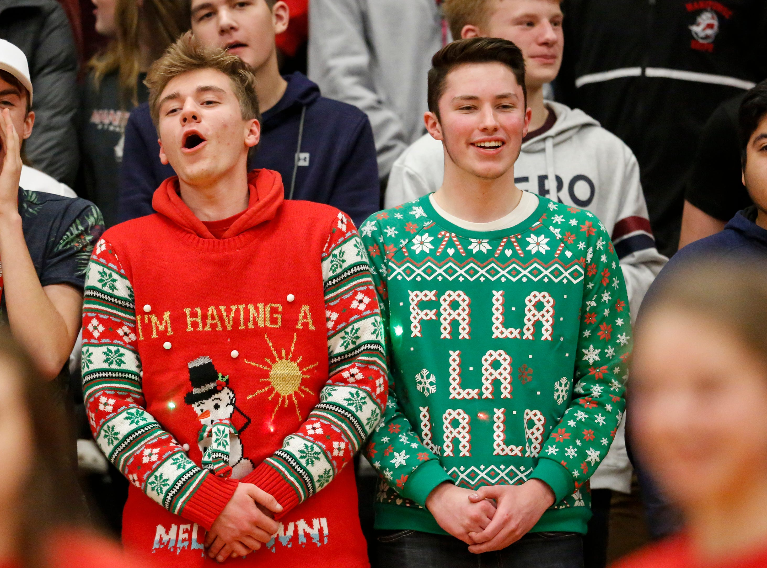 Manitowoc Lincoln's student section dons ugly Christmas sweaters as they cheer on their Ships' boys basketball team during an FRCC matchup against Green Bay Preble at Manitowoc Lincoln High School Friday, December 21, 2018, in Manitowoc, Wis. Joshua Clark/USA TODAY NETWORK-Wisconsin