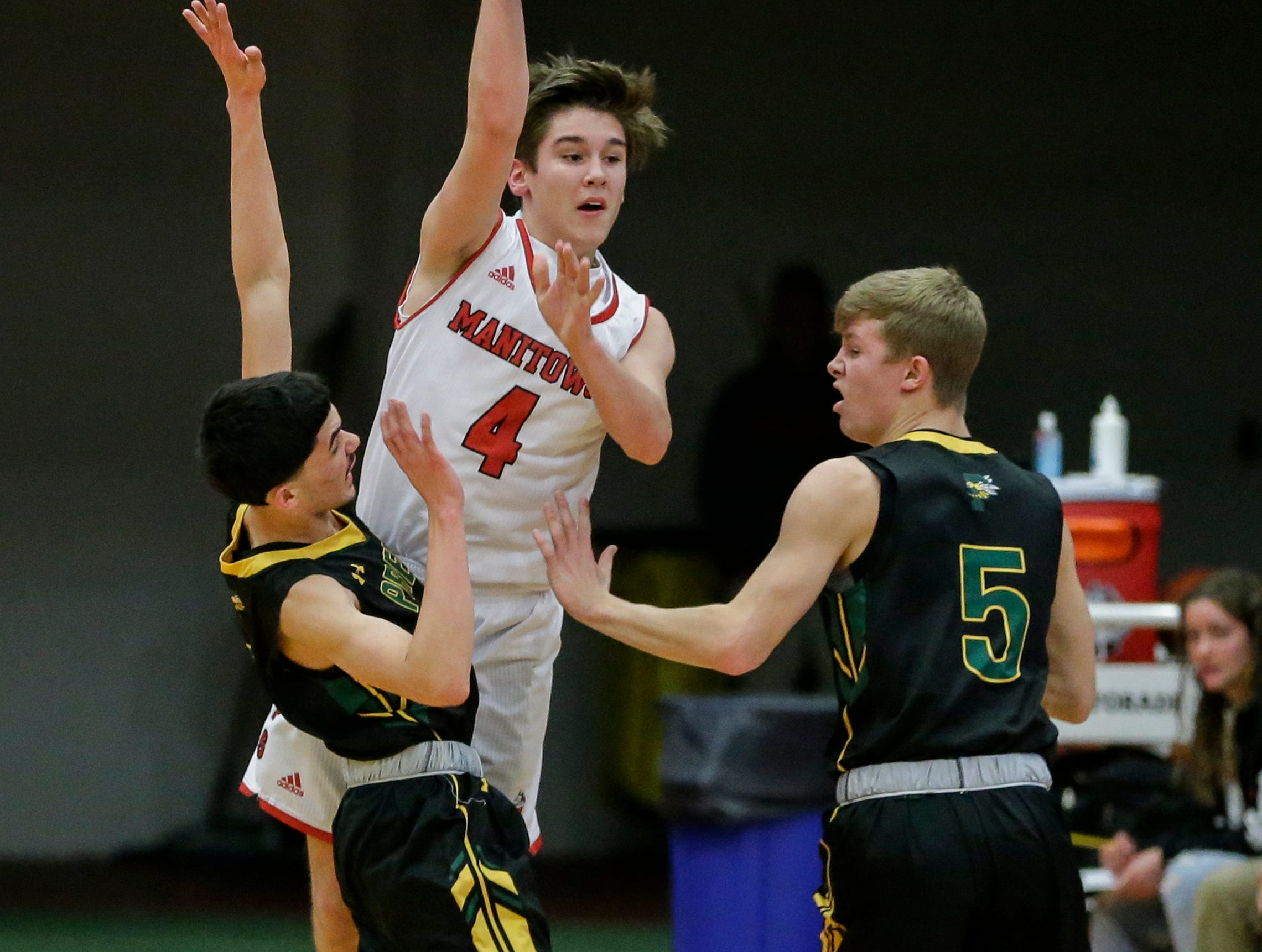 Manitowoc Lincoln's Mason Dopirak looks for an open man as Green Bay Preble puts on pressure during boys FRCC basketball at Manitowoc Lincoln High School Friday, December 21, 2018, in Manitowoc, Wis. Joshua Clark/USA TODAY NETWORK-Wisconsin