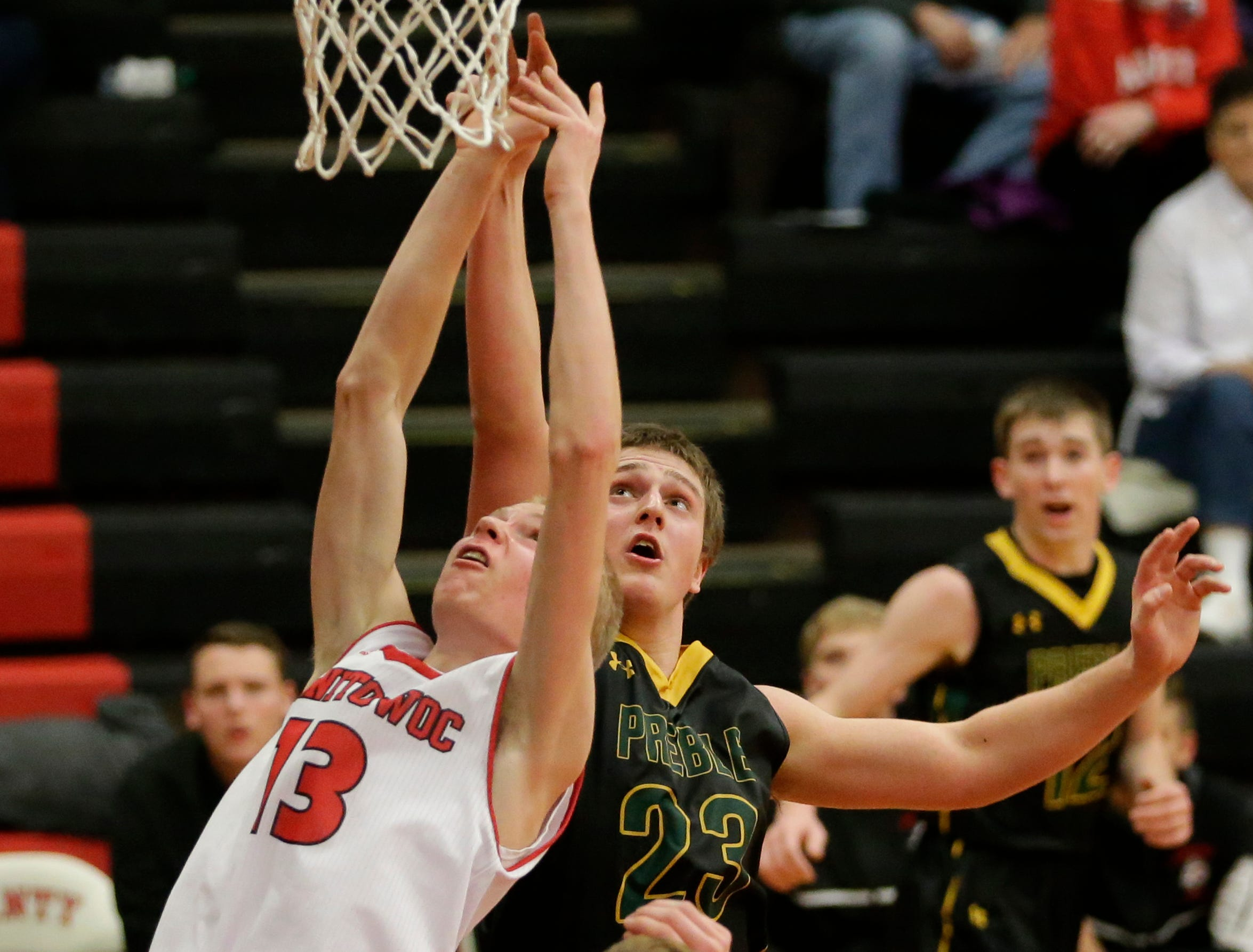 Manitowoc Lincoln's Sam Jacobson (13) battles Green Bay Preble's Bryan Boockmeier (23) for a rebound during boys FRCC basketball at Manitowoc Lincoln High School Friday, December 21, 2018, in Manitowoc, Wis. Joshua Clark/USA TODAY NETWORK-Wisconsin
