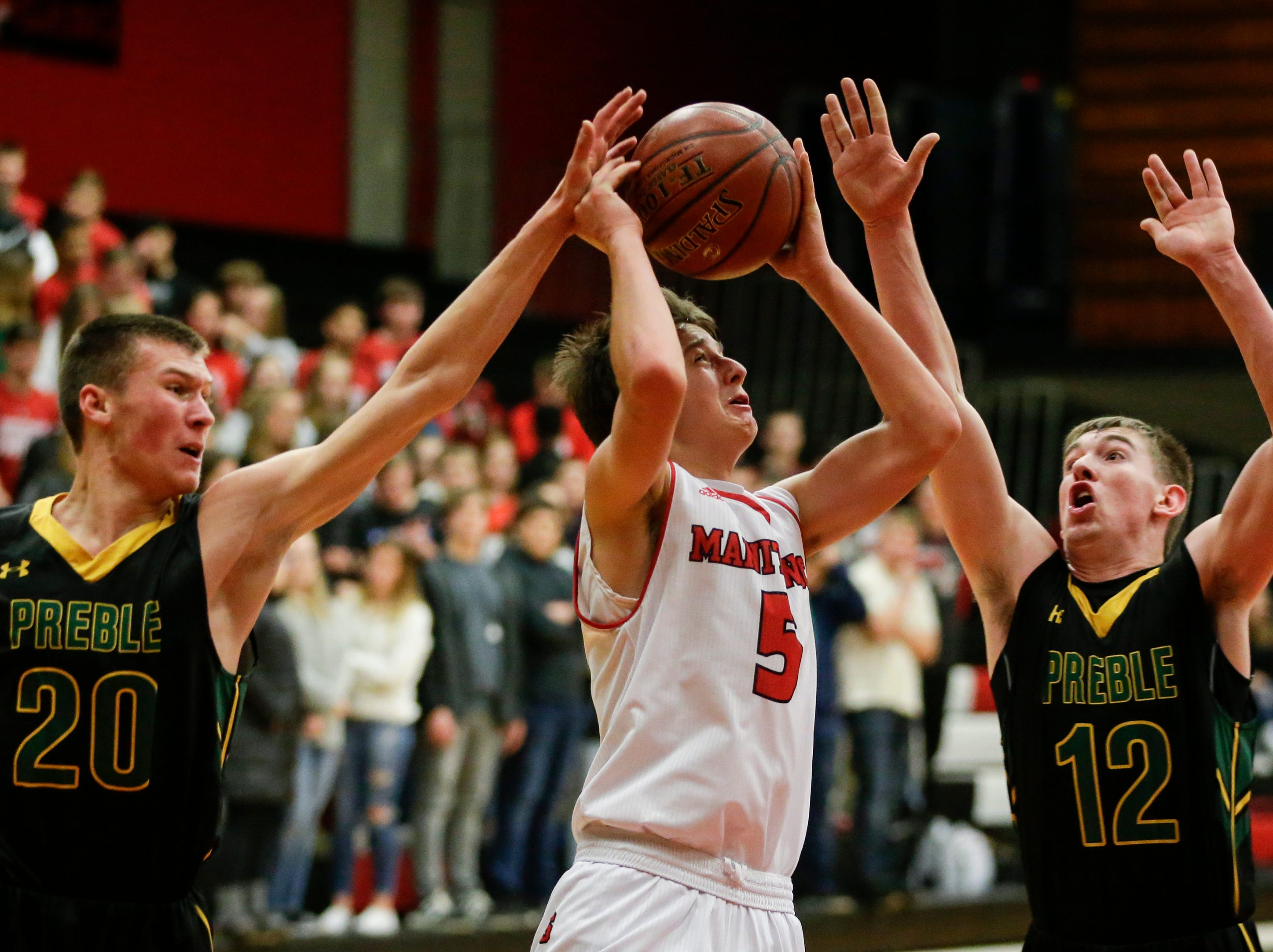 Manitowoc Lincoln's Josh Hoffman looks to shoot against Green Bay Preble during boys FRCC basketball at Manitowoc Lincoln High School Friday, December 21, 2018, in Manitowoc, Wis. Joshua Clark/USA TODAY NETWORK-Wisconsin
