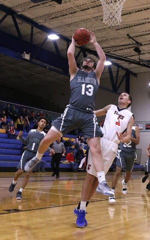 Madison's Tyler Tackett makes a jump shot while playing against Galion during the 419 Challenge at Ontario high School on Saturday.