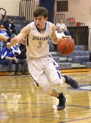 St. Peter's Caleb Stewart dribbles the ball down the court while playing against Crestline earlier this season.