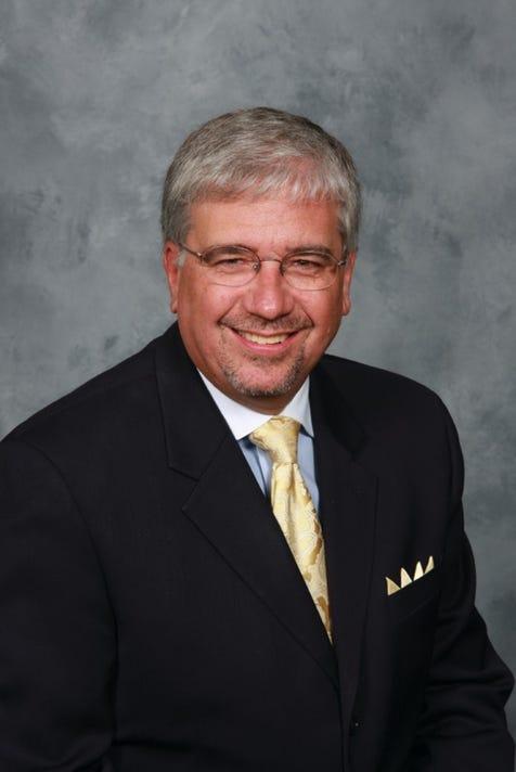 Dr Bruce Philippi