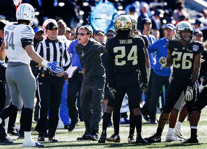 Memphis coach Mike Norvell (center) yells at the referee after a failed fake punt against Wake Forest in the Birmingham Bowl.