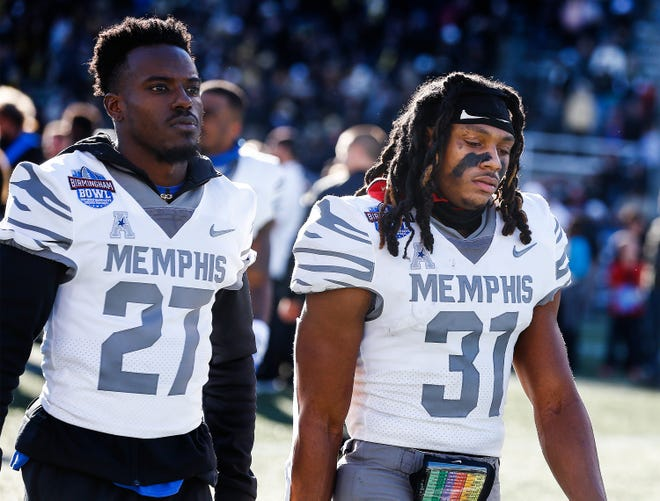 Memphis' Noah Arrindell (left) and Chris Claybrooks walk off the field after losing 37-34 to Wake Forest in the Birmingham Bowl on Saturday.