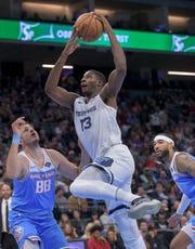 Memphis Grizzlies forward Jaren Jackson Jr. (13) attempts to score over Sacramento Kings forward Nemanja Bjelica (88) during the first quarter of an NBA basketball game in Sacramento, Calif. Friday, Dec. 21, 2018. (AP Photo/Randall Benton)