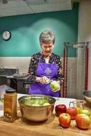 """Olga Page has taken both the beginner and intermediate series of Church Health's Culinary Medicine program. """"I decided if I was going to improve my skills in the kitchen, I should be be cooking healthier foods for myself,"""" she said."""