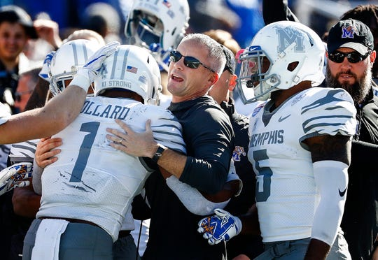 Memphis coach Mike Norvell (center) celebrates with wide receiver Tony Pollard (left) after his kickoff return for a touchdown against Wake Forest during action in the Birmingham Bowl football game Saturday, December 21, 2018 in Birmingham.