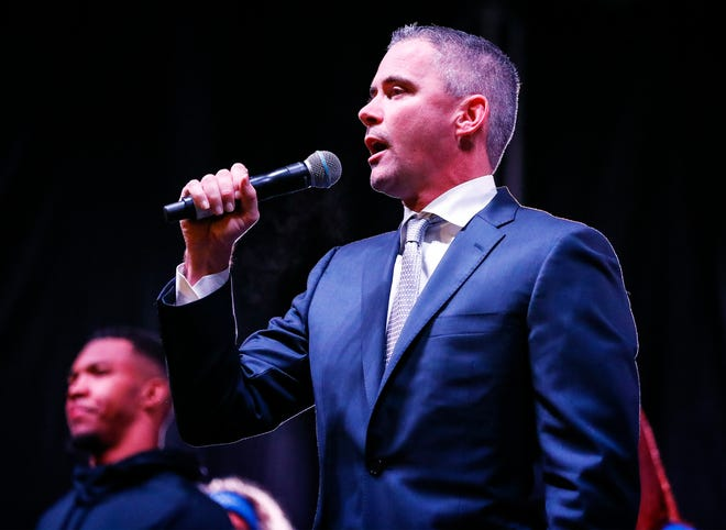 Memphis head coach Mike Norvell speaks to fans gathered at a pep rally leading up to Saturday's Birmingham Bowl game against Wake Forest.