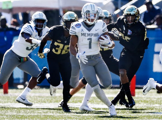 Memphis wide receiver Tony Pollard (center) scores for his first kickoff return for a touchdown during action against Wake Forest in the Birmingham Bowl football game Saturday, December 21, 2018 in Birmingham.