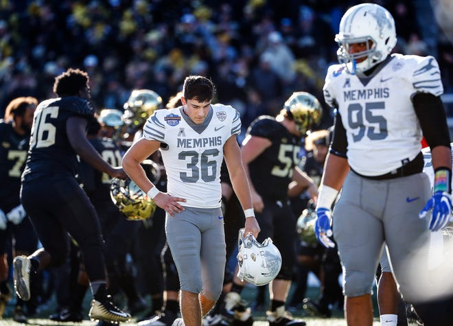 Memphis kicker Riley Patterson (middle) walks off the field Saturday after missing a 43-yard field-goal attempt as time expired.