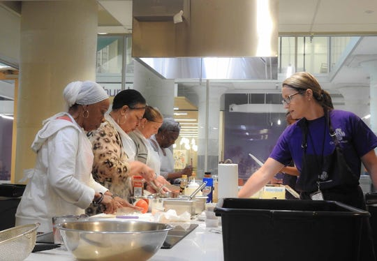 Students get hands-on cooking experience at Church Health's Culinary Medicine cooking classes.