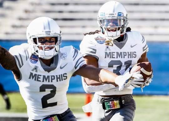 Memphis defensive back Chris Claybrooks (right) celebrates an interception return for a touchdown with TJ Carter (left) against Wake Forest during action in the Birmingham Bowl football game Saturday, December 21, 2018 in Birmingham.