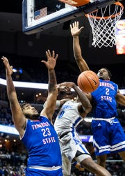 Tennessee State forward Emmanuel Egbuta (2) blocks a shot attempt by Memphis forward Kevin Davenport (0) during the first half of a  basketball game between, Saturday, Dec. 22, 2018