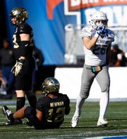 Memphis defender Austin Hall (right) celebrates a sack against Wake Forest during action in the Birmingham Bowl football game Saturday, December 21, 2018 in Birmingham.