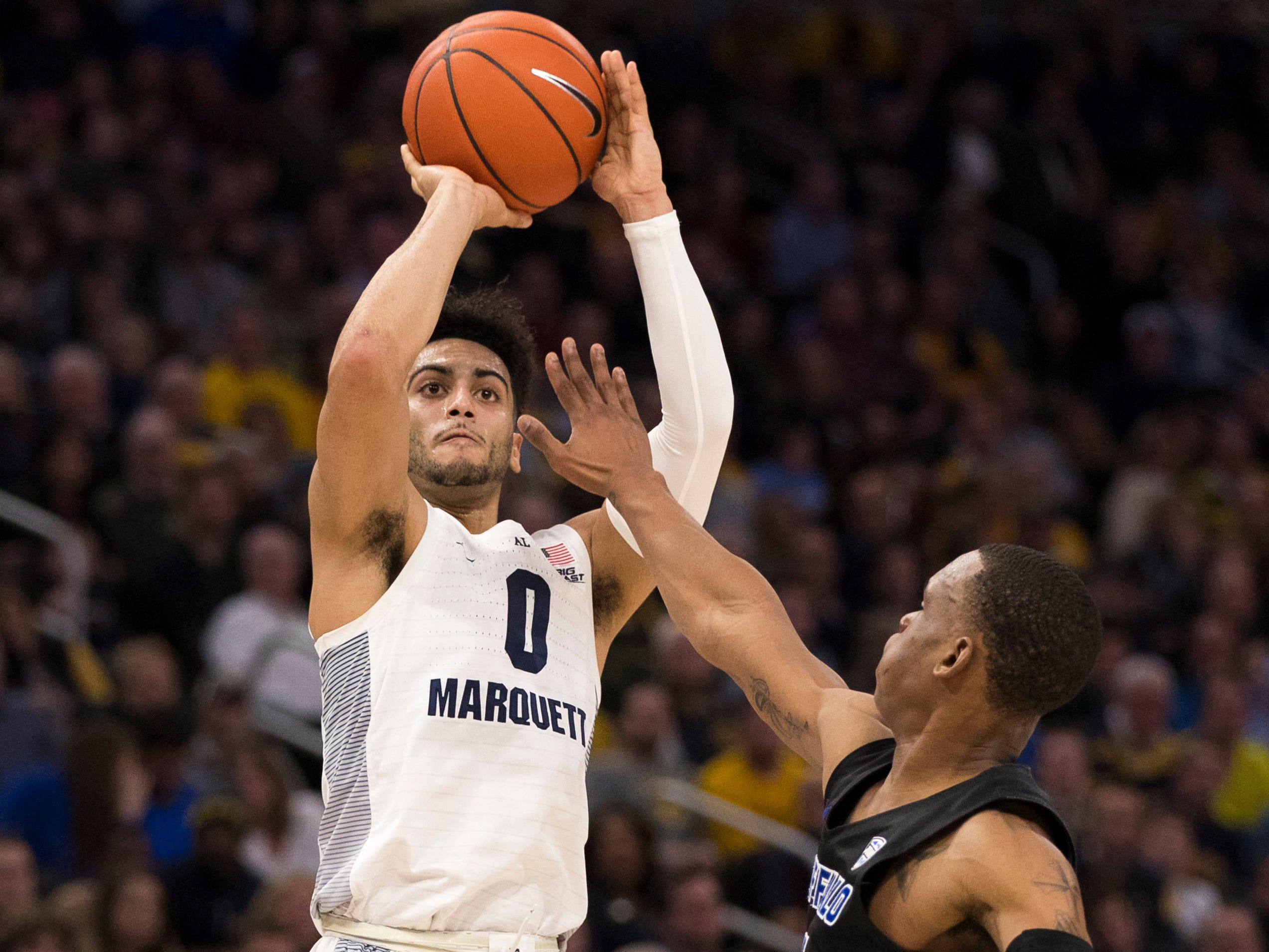 Golden Eagles guard Markus Howard launches a three-pointer against Buffalo in the second half on Friday night. Howard hit 8 of 10 three-pointers after the break as he scored 40 of his 45 points after halftime.