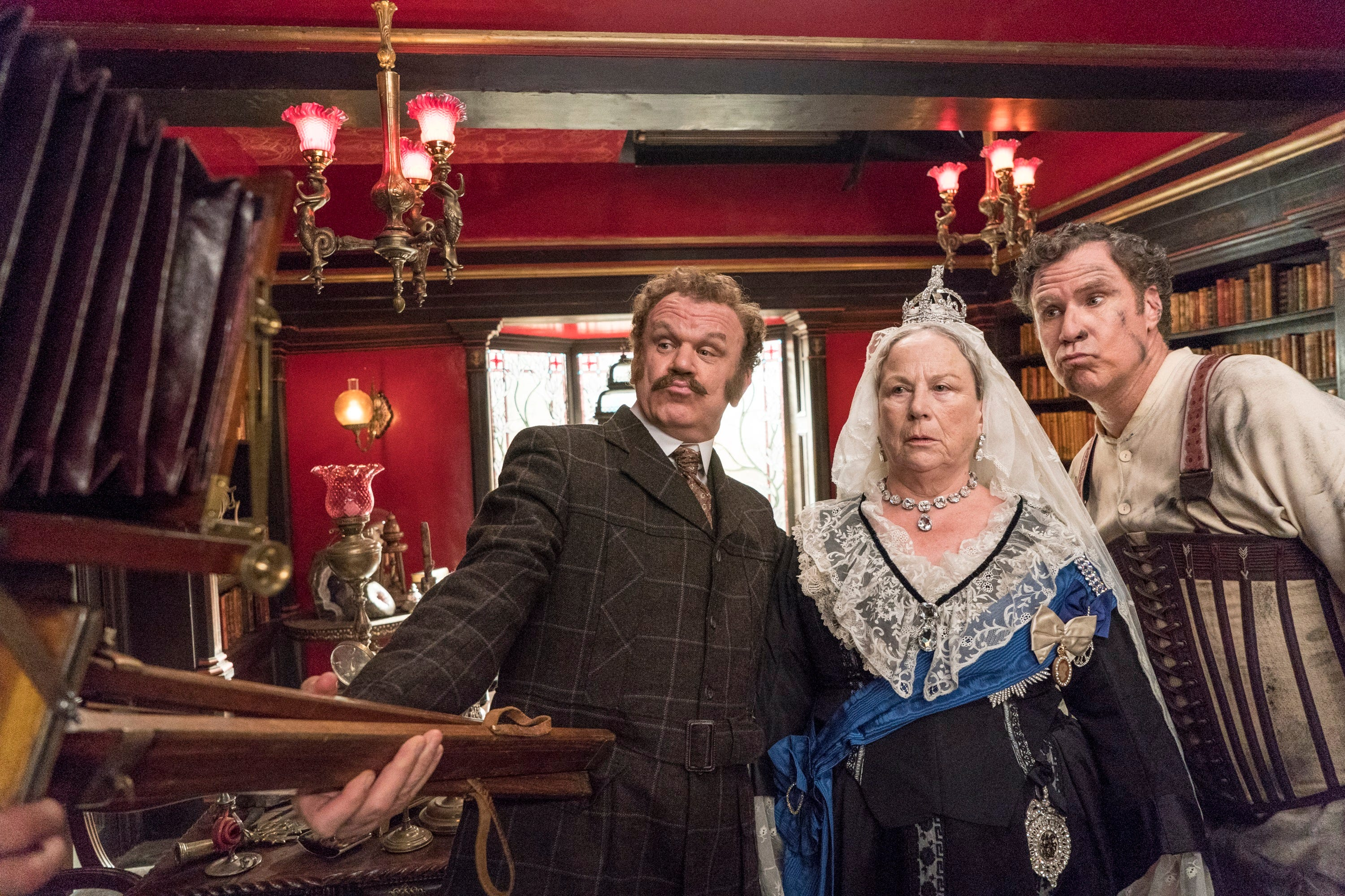 """Dr. John Watson (John C. Reilly, left) and Sherlock Homes (Will Ferrell, right) pose for a 19th-century selfie with Queen Victoria (Pam Ferris) in """"Holmes & Watson."""" No, really."""
