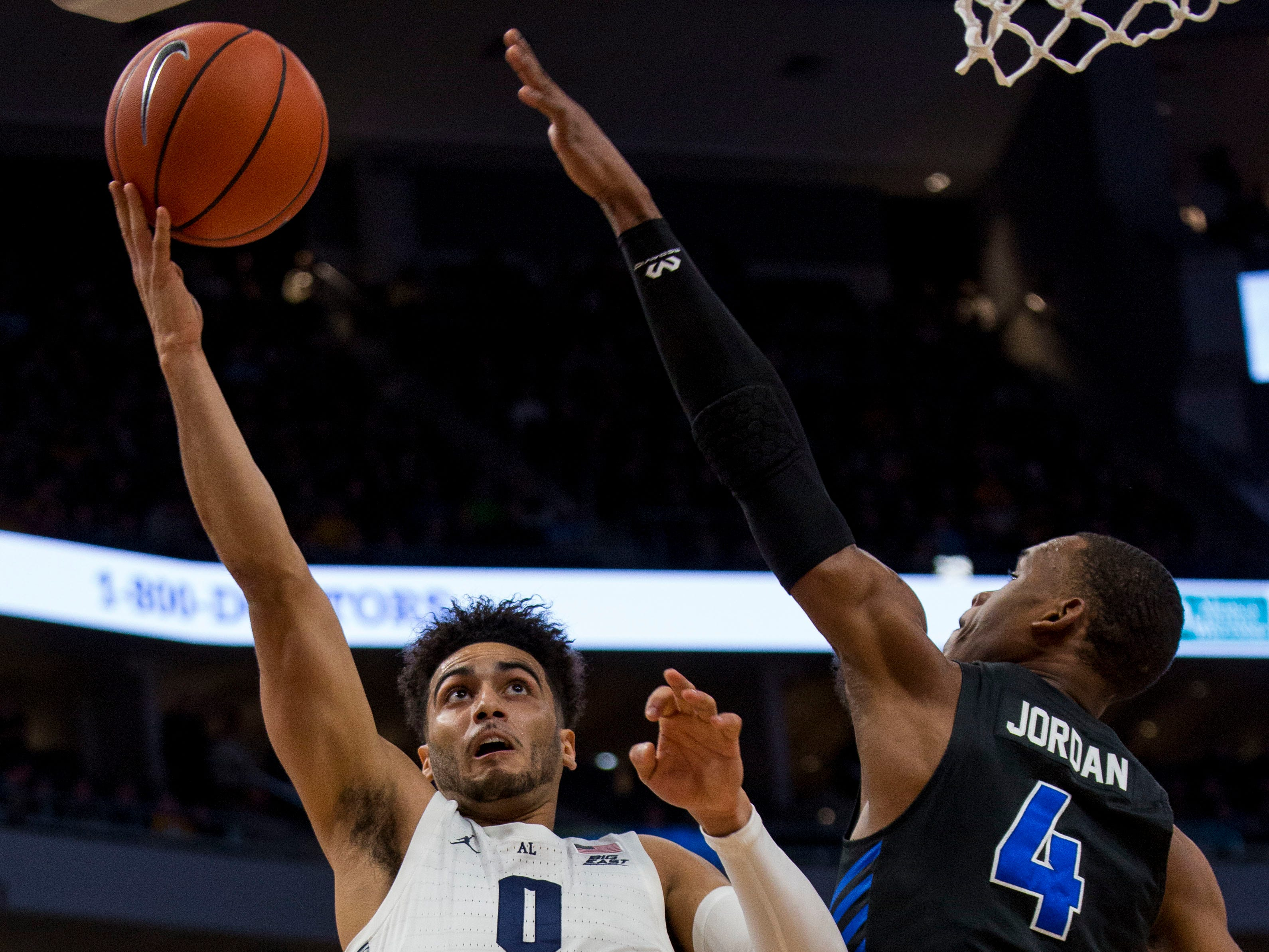 Marquette guard Markus Howard goes up for a shot against Buffalo guard Davonta Jordan during the first half Friday night.