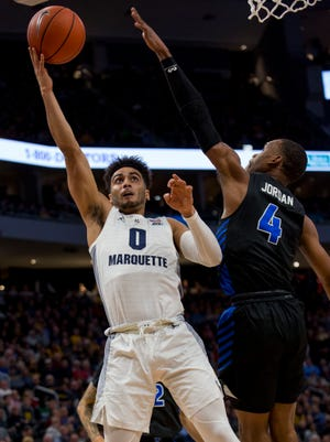 Marquette guard Markus Howard goes up for a shot against Buffalo's Davonta Jordan on Friday night at Fiserv Forum.