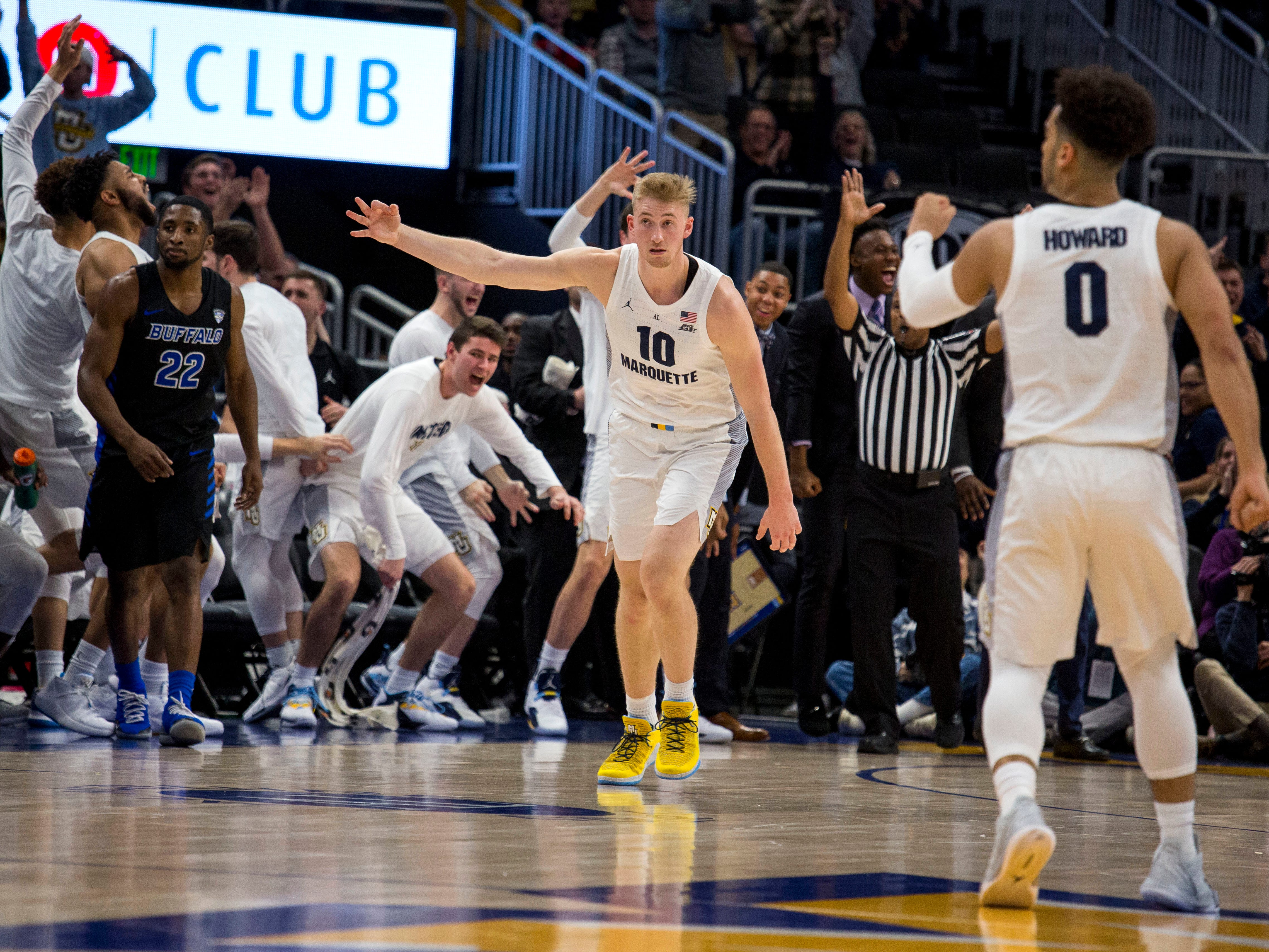 Golden Eagles forward Sam Hauser motions to the Marquette bench after hitting a three-pointer in the second half against Buffalo. Hauser hit a three of his three-point attempts but he also fouled out.