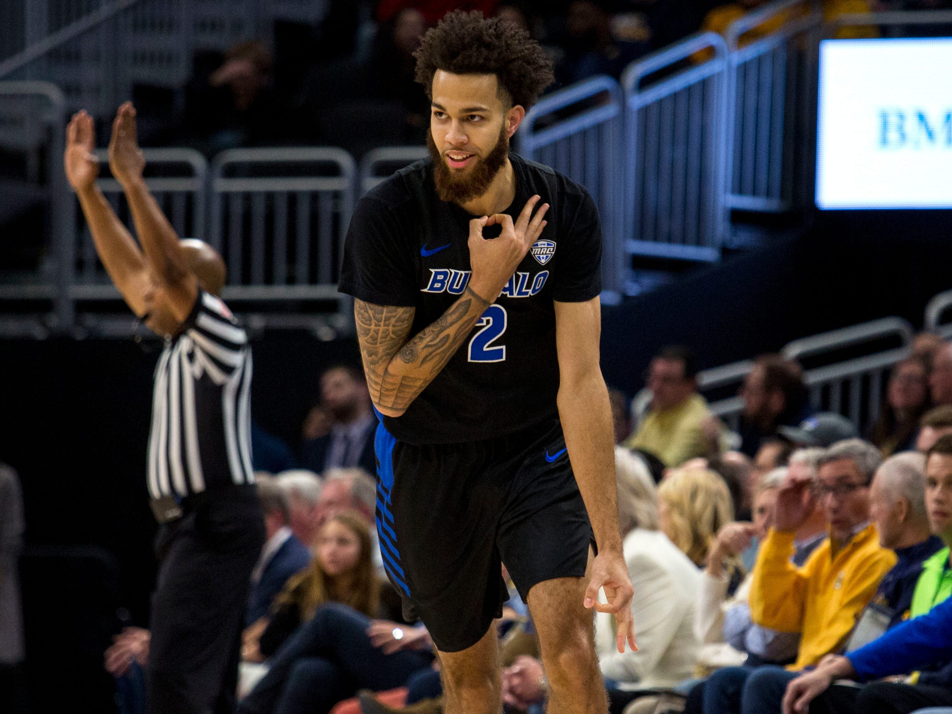Buffalo guard Jeremy Harris gestures after making a three-pointer basket against Marquette during the first half Friday.