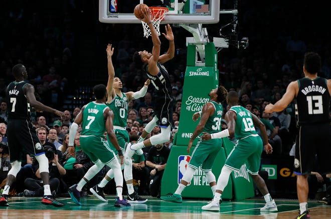 Bucks forward Giannis Antetokounmpo goes up for two of his 30 points against the Celtics on Friday night at TD Garden in Boston.