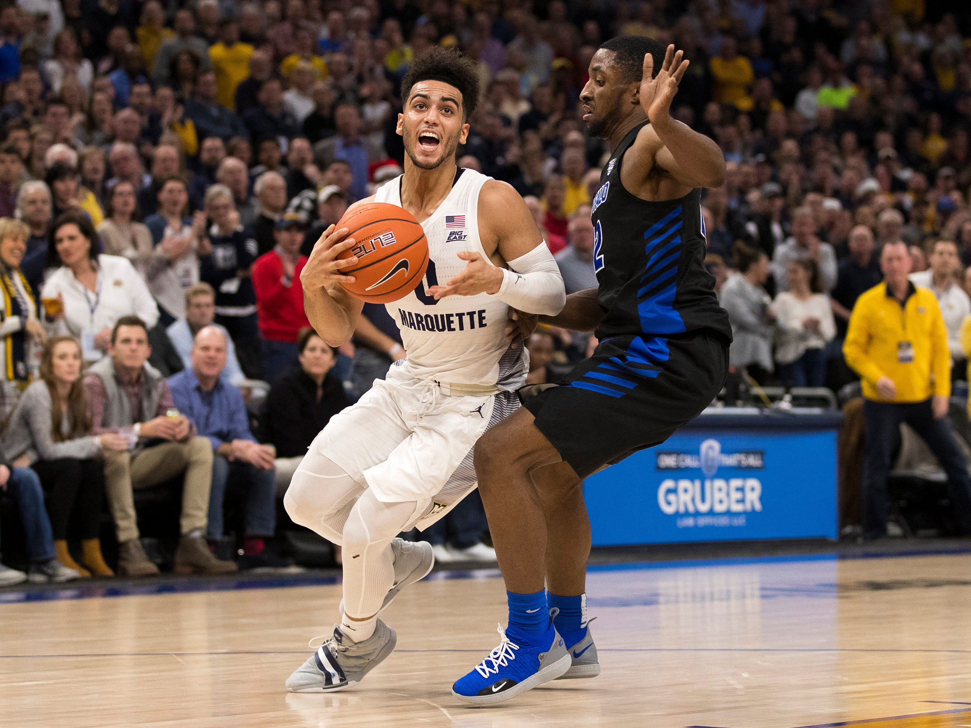 Golden Eagles guard Markus Howard drives to the basket against Buffalo guard Dontay Caruthers during the second half Friday night. Howard scored 40 of his 45 points in the second half.