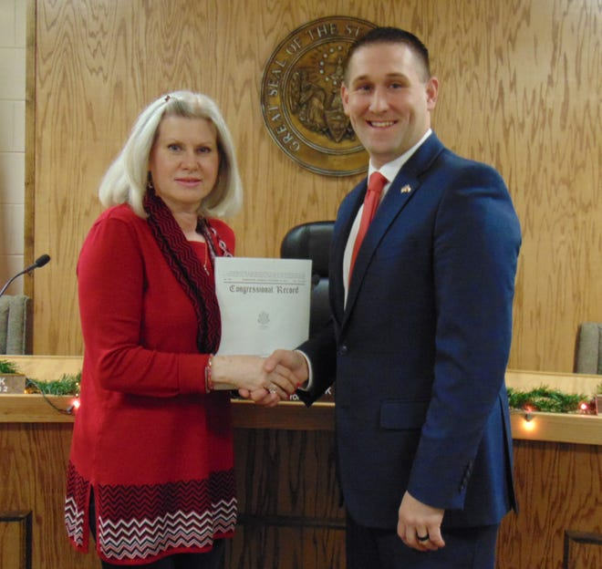 Cotter Mayor Peggy Hammack (left) was recently recognized by U.S. Rep. Rick Crawford from the floor of the House. On Thursday, Stetson Painter (right), a field representative for Rep. Crawford, presented the mayor with a copy of the Congressional Record containing Crawford's remarks.