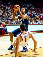Dec 21, 2018; Tuscaloosa, AL, USA; Penn State Nittany Lions forward Lamar Stevens (11) is called for a charge against Alabama Crimson Tide guard Riley Norris (1) during the first half of an at Coleman Coliseum. Mandatory Credit: Butch Dill-USA TODAY Sports