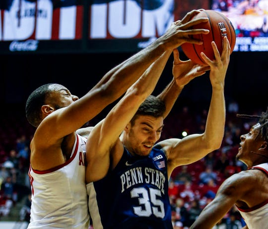 Dec 21, 2018; Tuscaloosa, AL, USA; Alabama Crimson Tide forward Galin Smith (30) and Penn State Nittany Lions forward Trent Buttrick (35) battle for a rebound during the first half of an at Coleman Coliseum. Mandatory Credit: Butch Dill-USA TODAY Sports
