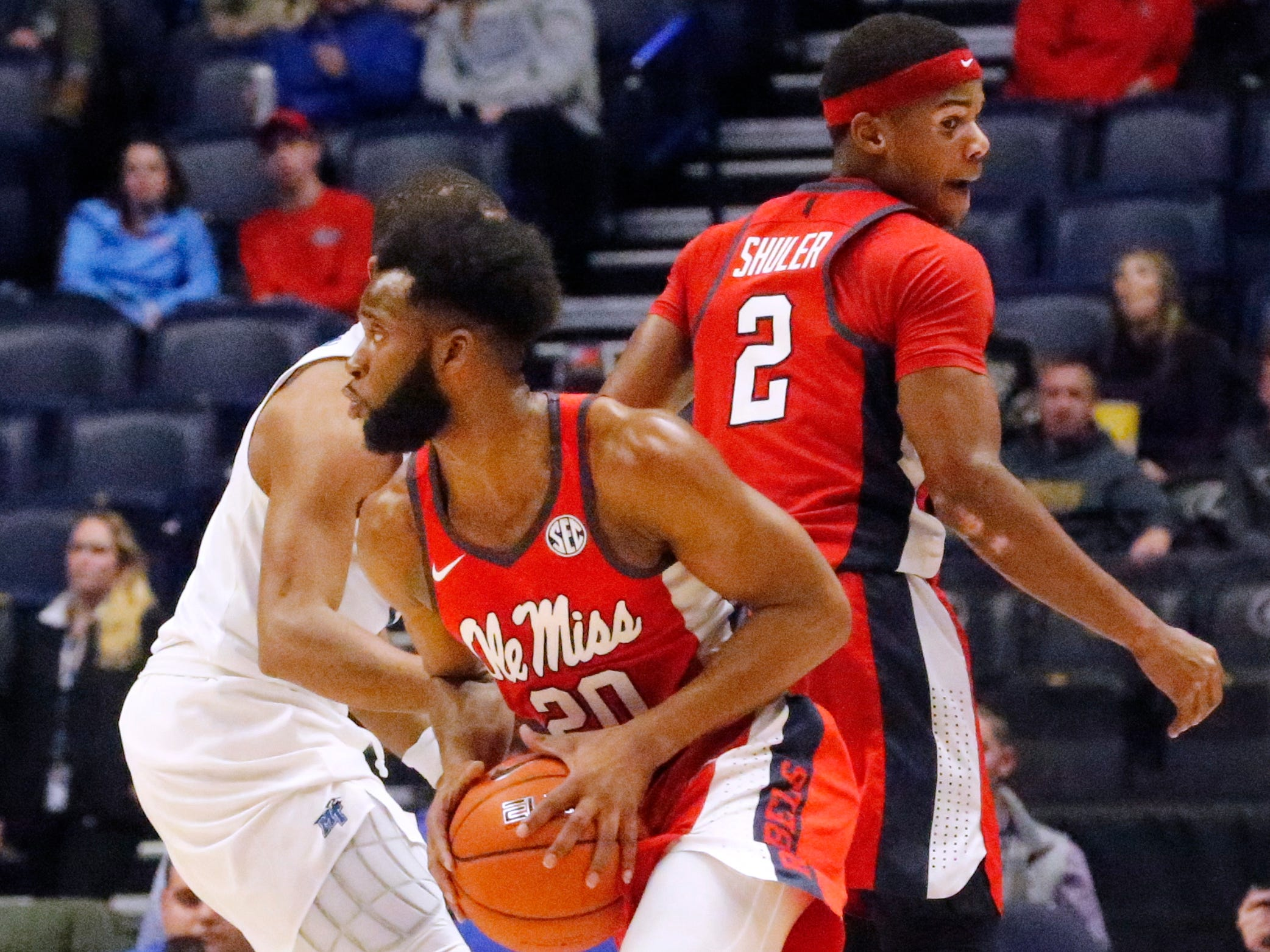 Ole Miss' guard D.C. Davis (20) moves the ball around the court during the game against MTSU on Friday Dec. 21, 2018, at Bridgestone Arena.