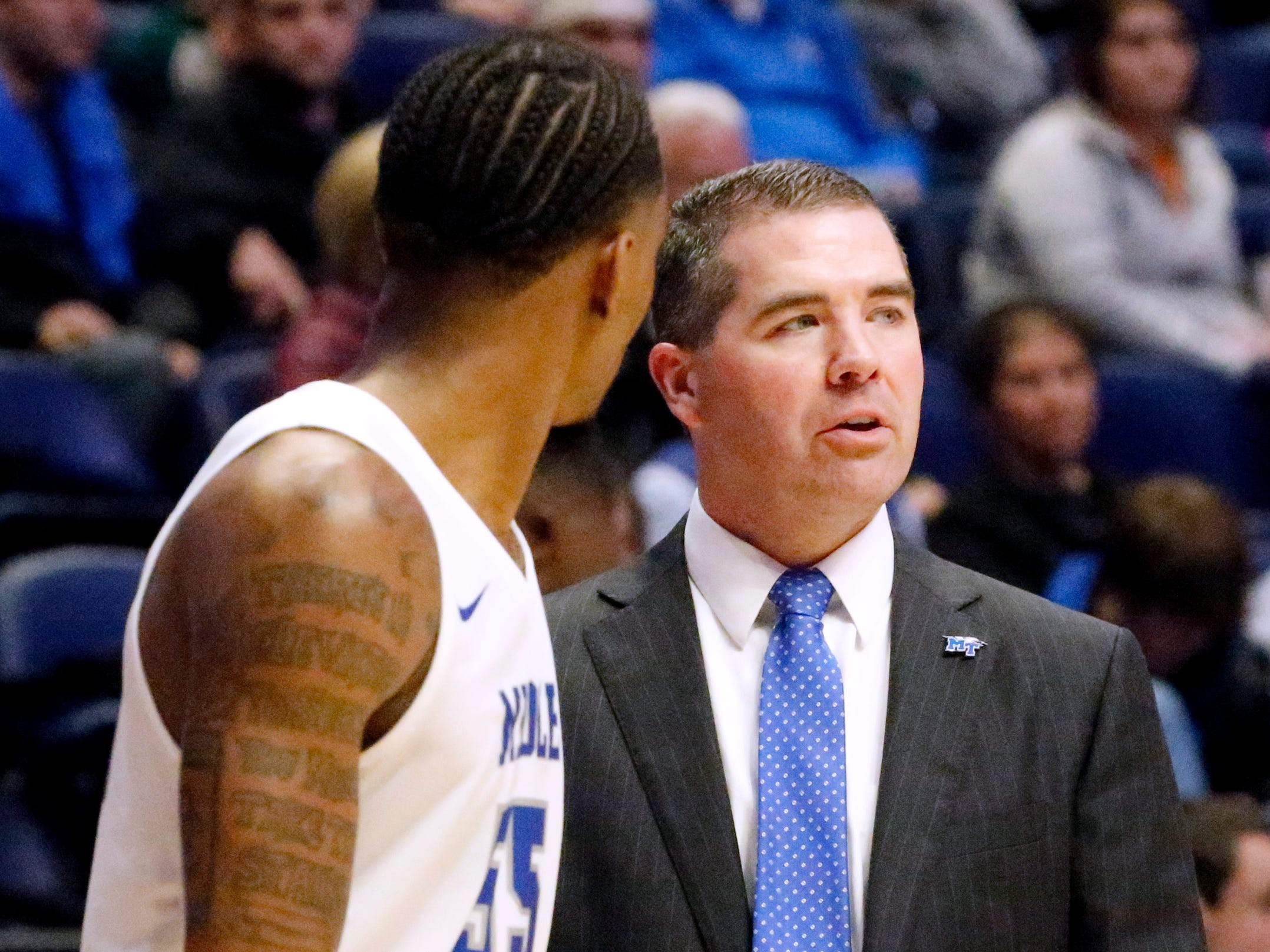 MTSU's head coach Nick McDevitt on the sideline with MTSU's guard Antonio Green (55) during the game against against Ole Miss on Friday Dec. 21, 2018, at Bridgestone Arena.