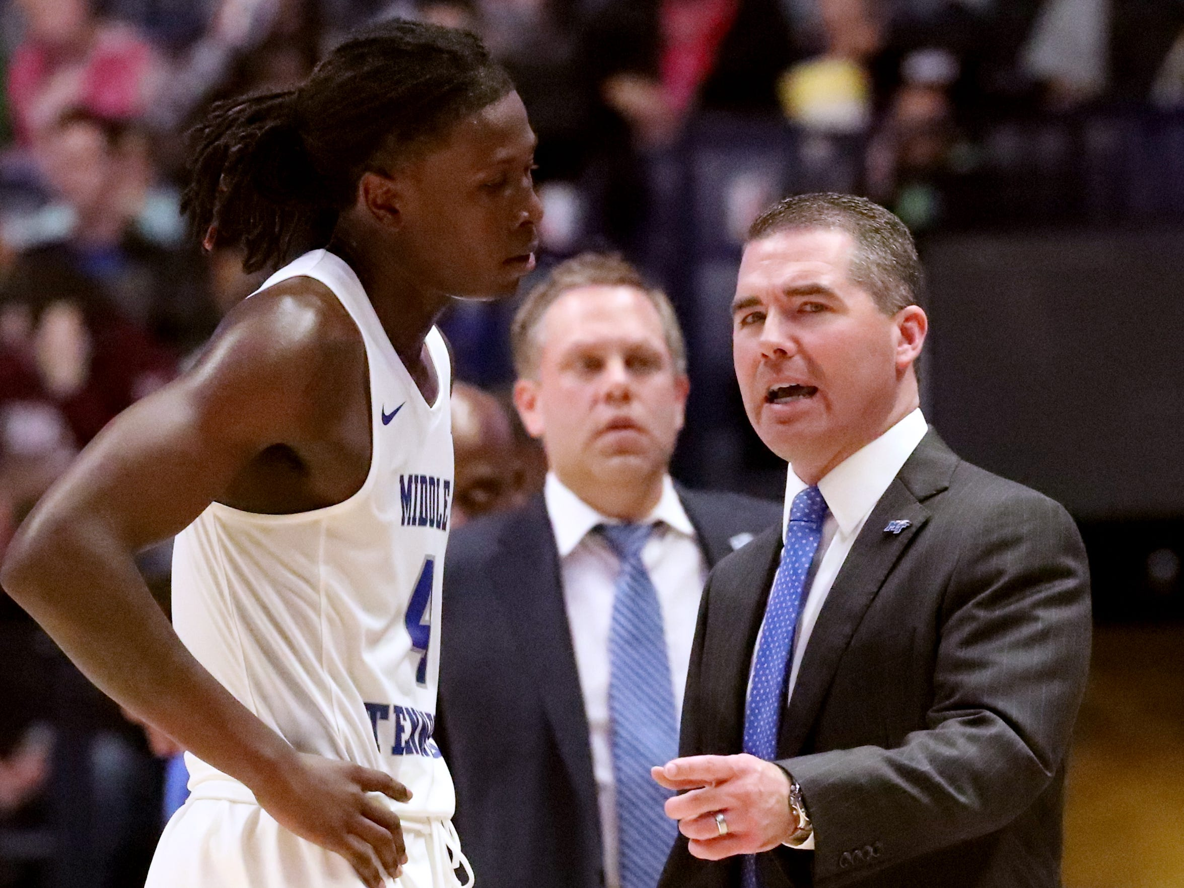 MTSU's head coach Nick McDevitt talks with MTSU's forward James Hawthorne (4) on the sidelines during the game against against Ole Miss on Friday Dec. 21, 2018, at Bridgestone Arena.