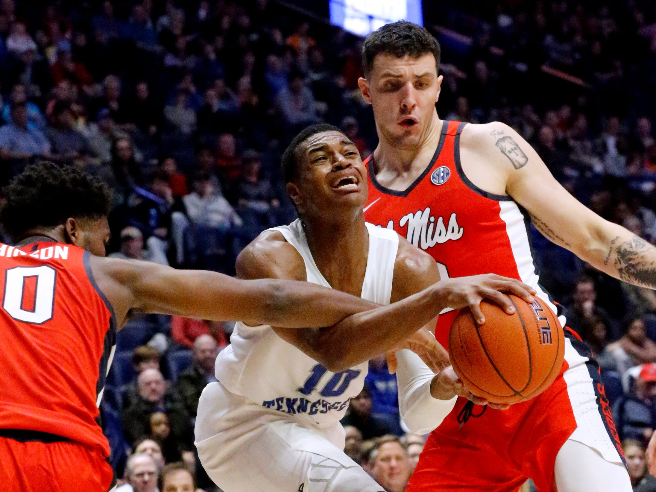 MTSU's guard Jayce Johnson (10) pushes toward the basket as Ole Miss' guard Blake Hinson (0) and Ole Miss' center Dominik Olejniczak (13) guard him on Friday Dec. 21, 2018, at Bridgestone Arena.