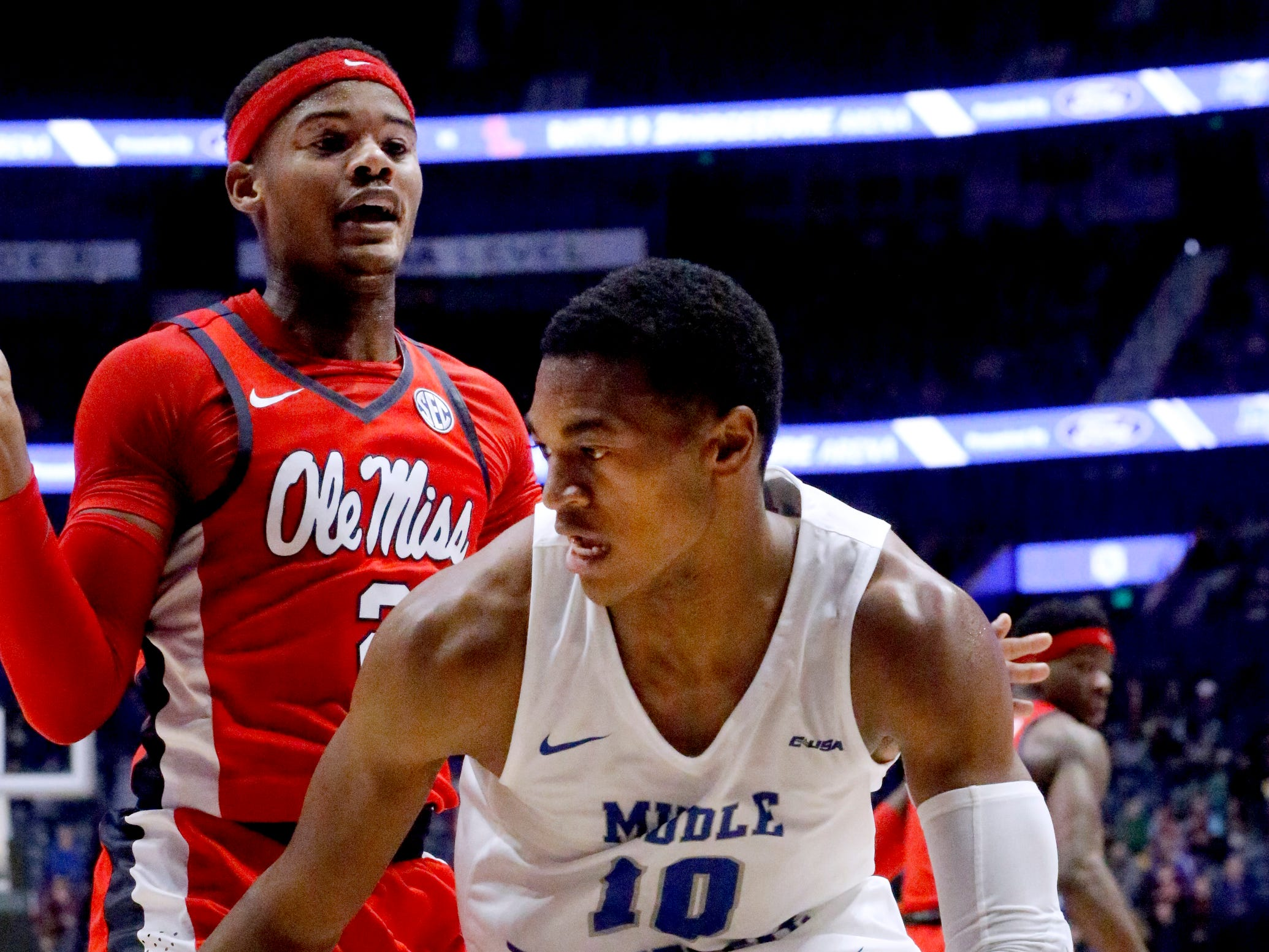 MTSU's guard Jayce Johnson (10) drives to the basket as Ole Miss' guard Terence Davis (3) guards him on Friday Dec. 21, 2018, at Bridgestone Arena.