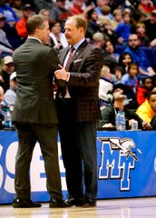 MTSU's head coach Nick McDevitt and Ole Miss' head coach Kermit Davis meet in the middle of the sidelines after MTSU loses two Ole Miss 74-56, on Friday Dec. 21, 2018, at Bridgestone Arena.