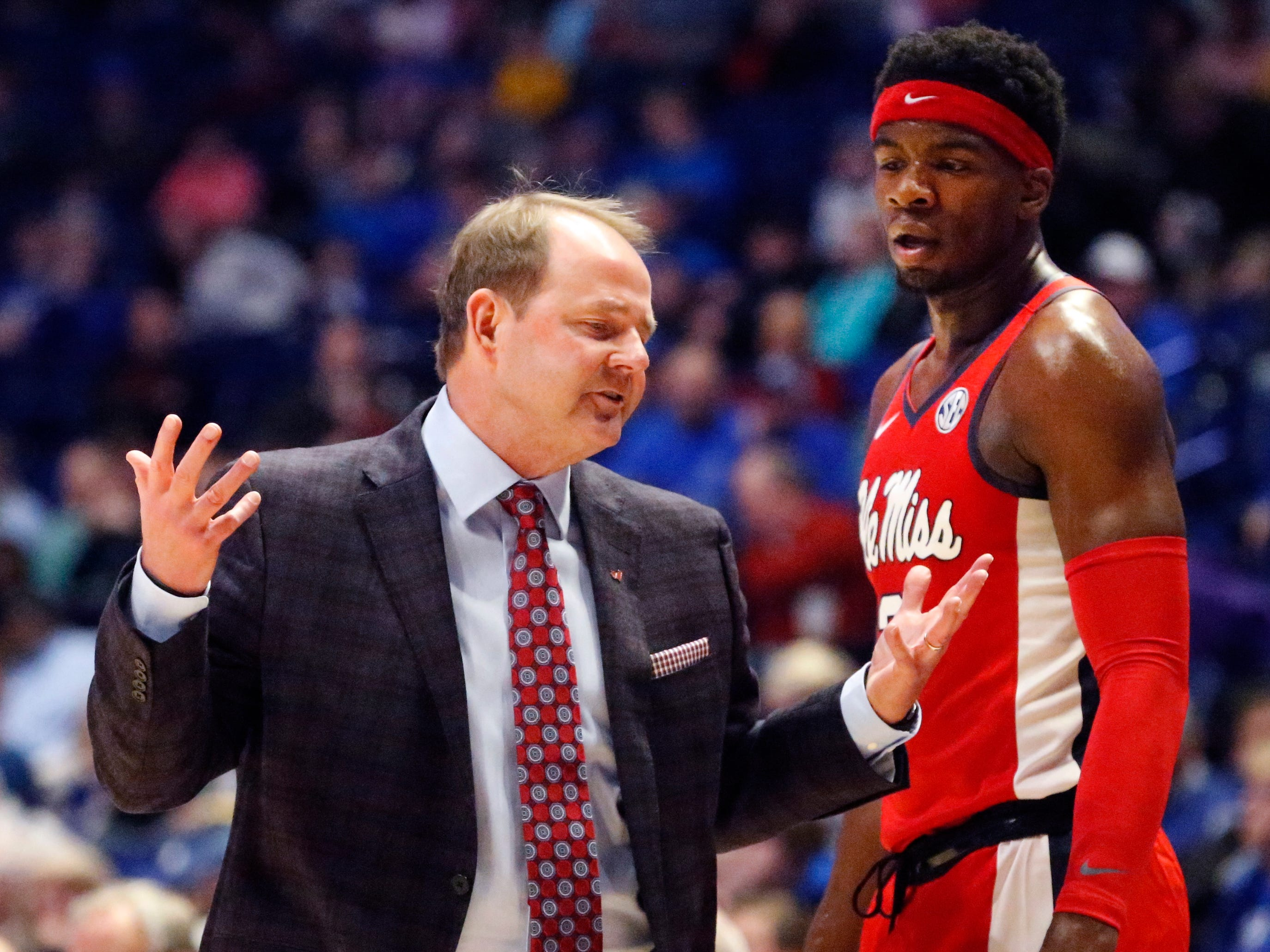 Ole Miss' head coach Kermit Davis talks with Ole Miss' guard Terence Davis (3) on the sidelines during the game against MTSU on Friday Dec. 21, 2018, at Bridgestone Arena.